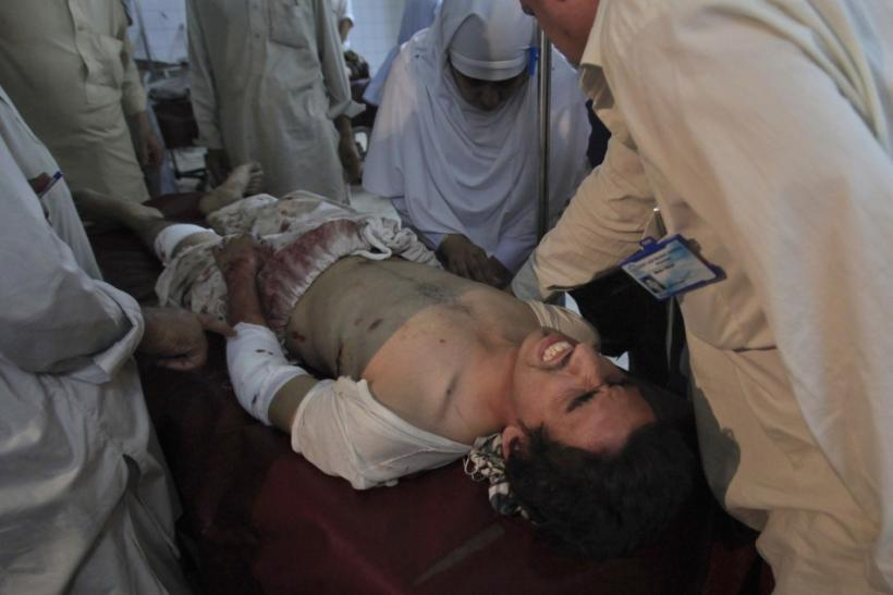 A nurse attends to a man who was injured by a bomb blast at hospital in Peshawar