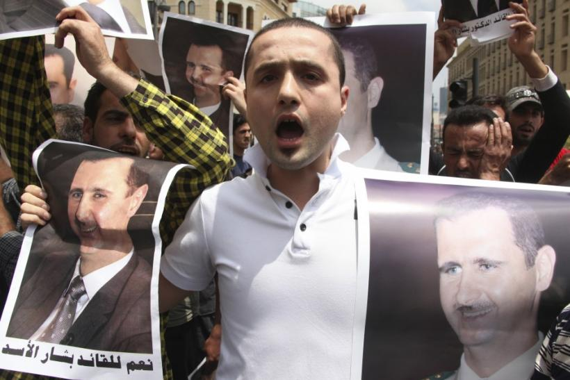 Protesters chant slogans in support of Syrian President Bashar al-Assad in Beirut