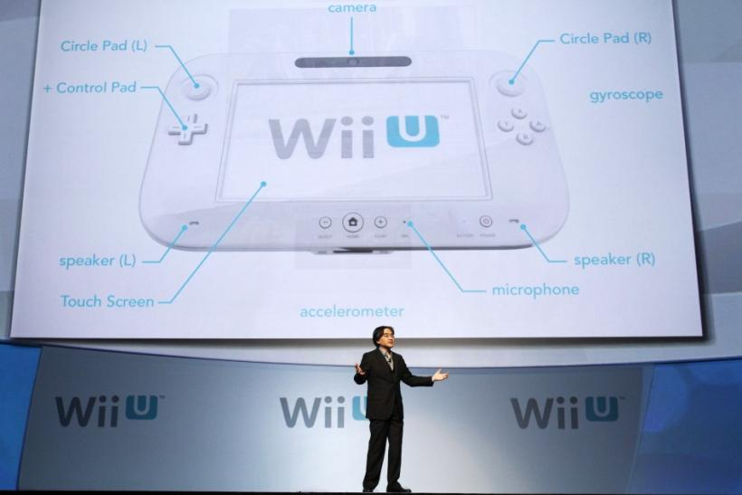 Satoru Iwata, president of Nintendo Co., Ltd., presents the new Wii U controller at a media briefing during the Electronic Entertainment Expo, or E3, in Los Angeles June 7, 2011