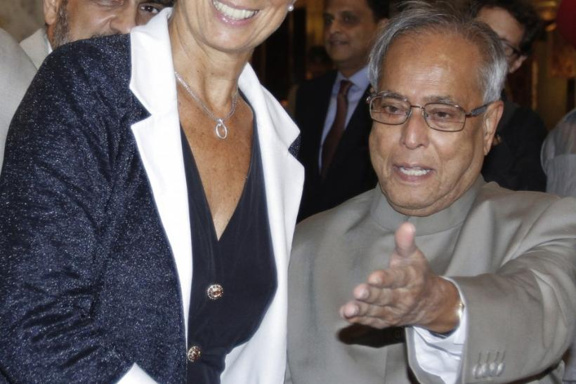 Christine lagarde, Mukherjee