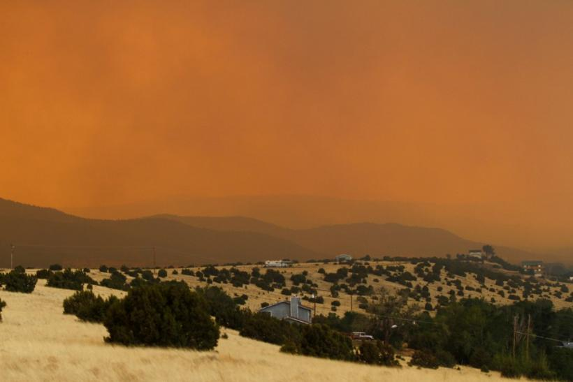 Smoke from the Wallow Wildfire rises over Round Valley High School Stadium in Springerville