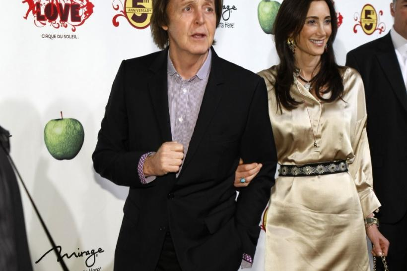 "Paul McCartney (L) and Nancy Shevell arrive for the fifth anniversary celebration of ""The Beatles LOVE by Cirque du Soleil"" show at the Mirage Hotel and Casino in Las Vegas, Nevada June 8, 2011."