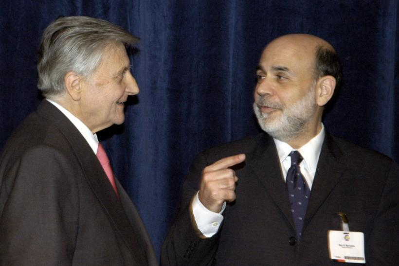 US Federal Reserve Chairman Bernanke and European Central Bank President Trichet talk before the European Central Bank's central Banking Conference in Frankfurt