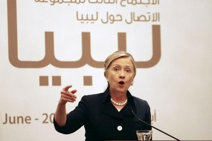 U.S. Secretary of State Hillary Clinton speaks during a news conference after the third contact group meeting on Libya, in Abu Dhabi