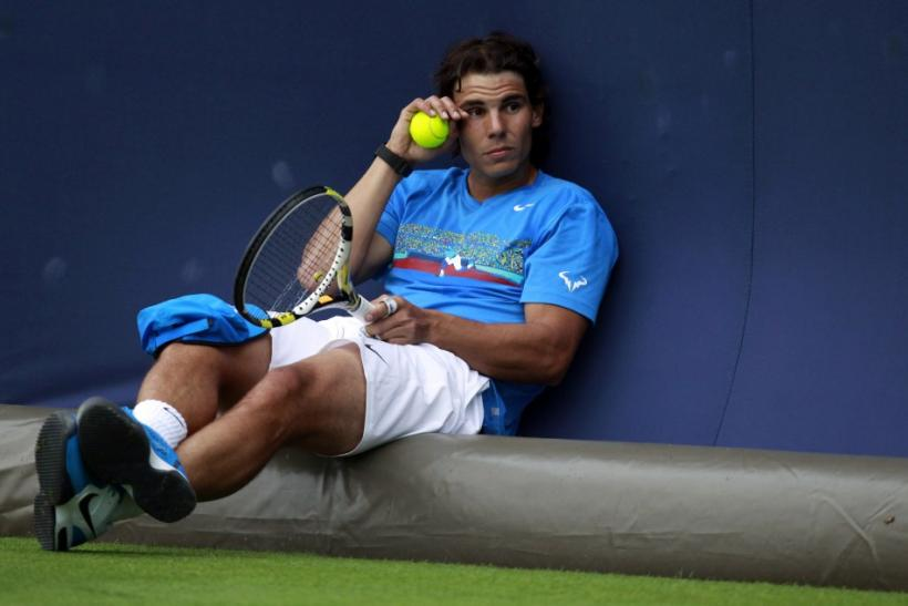 Nadal of Spain takes a break during a training session at the Queen's Club Championships in west London