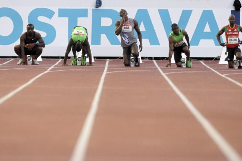 Athletes prepare for the 100 meters men's race at the IAAF World Challenge Ostrava Golden Spike meeting in Ostrava May 31, 2011.