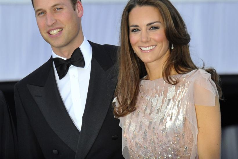 Britain's Prince William and his wife Catherine, Duchess of Cambridge pose for photographers as they arrive for a charity dinner at Kensington Palace in London June 9, 2011.