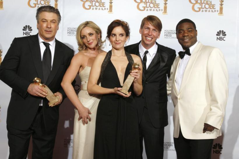 "Cast of ""30 Rock"" (L-R) Alec Baldwin, Jane Krakowski, Tina Fey, Jack McBrayer and Tracy Morgan pose backstage after their show won the Best Television Series - Musical Or Comedy award at the 66th annual Golden Globe awards in Beverly Hills, Cali"