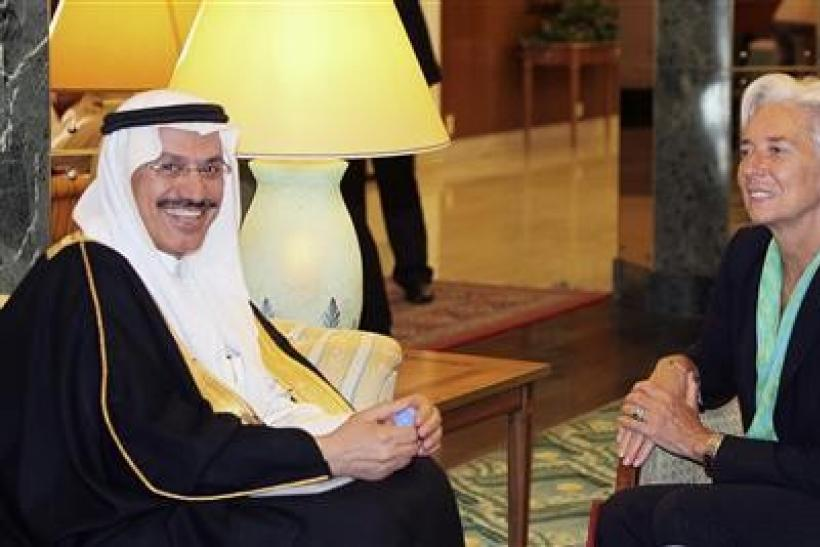 France's Finance Minister Christine Lagarde (R) meets with Muhammad al-Jasser, governor of the Saudi Arabian Monetary Agency (SAMA), in Jeddah June 11, 2011.