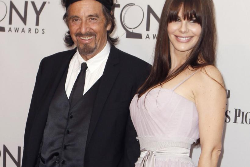 Actor Al Pacino and guest arrive for the American Theatre Wing's 65th annual Tony Awards ceremony in New York