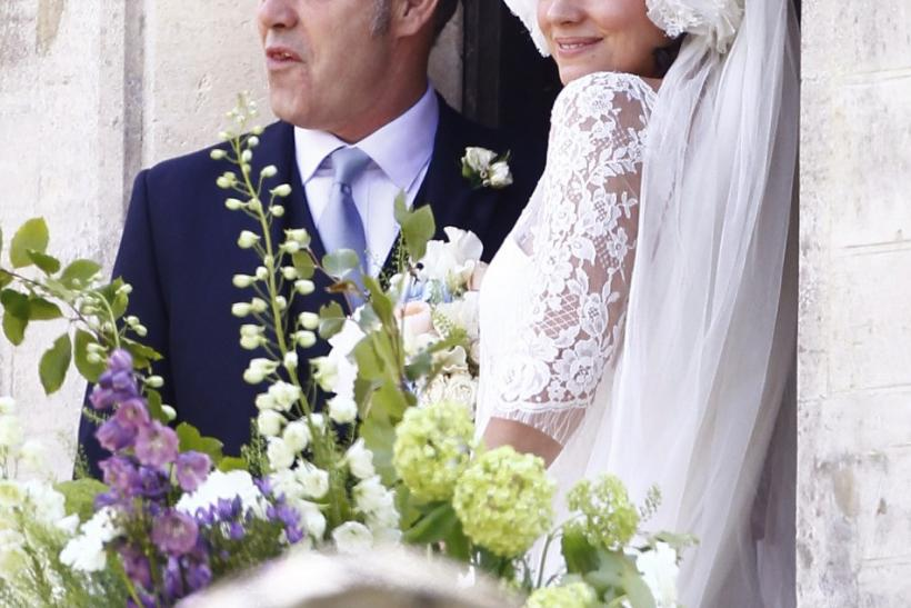 British Singer Lily Allen waits with her father Keith to walk down the aisle during her wedding to Sam Cooper at St James the Great Church in Cranham, Gloucestershire, western England, June 11, 2011