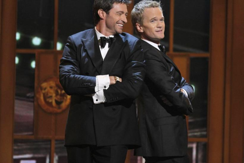 Actor Hugh Jackman performs with host Neil Patrick Harris during the American Theatre Wing's 65th annual Tony Awards ceremony in New York, June 12, 2011.