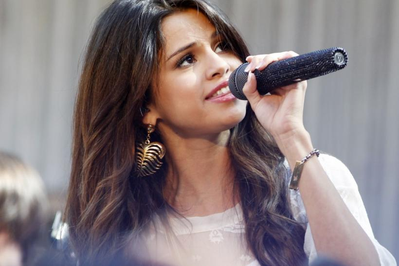 """Singer and actress Selena Gomez poses for photographers during an appearance at the Santa Monica Place mall to promote her new movie """"Monte Carlo"""" in Santa Monica, California June 13, 2011. Gomez was due to make the promotional appearance June 1"""