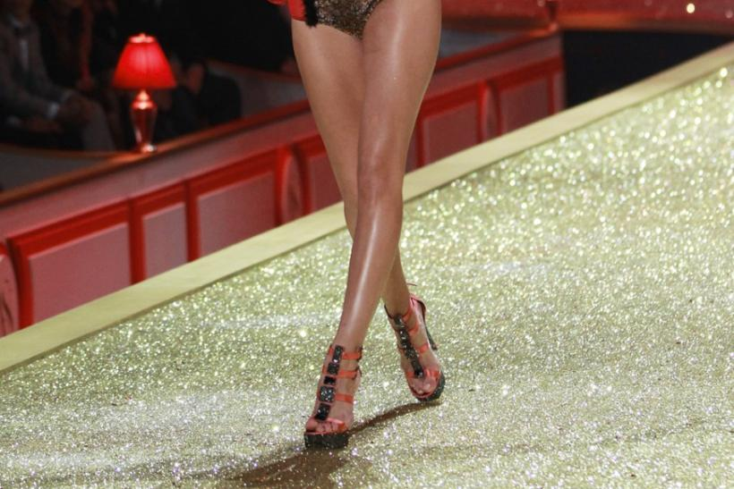 Model Rosie Huntington presents a creation during the Victoria's Secret Fashion Show in New York