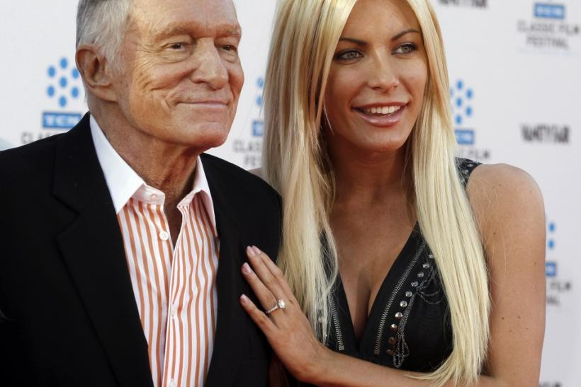 Hugh Hefner and his fiancee, Playboy Playmate Crystal Harris, arrive at the opening night gala of the 2011 TCM Classic Film Festival featuring a screening of a restoration of 'An American In Paris' in Hollywood, California April 28, 2011.