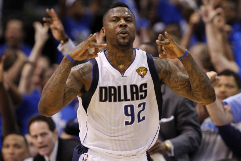 Dallas Mavericks' DeShawn Stevenson celebrates a three pointer against the Miami Heat during Game 4 of the NBA Finals basketball series in Dallas, June 7, 2011.