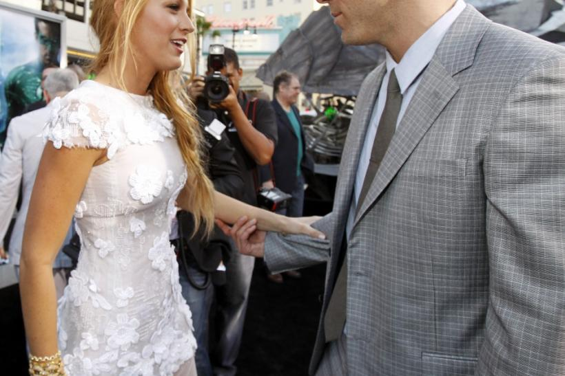"""Cast members Ryan Reynolds and Blake Lively greet each other at the premiere of """"Green Lantern"""" at the Grauman's Chinese theatre in Hollywood, California June 15, 2011. The movie opens in the U.S. on June 17."""