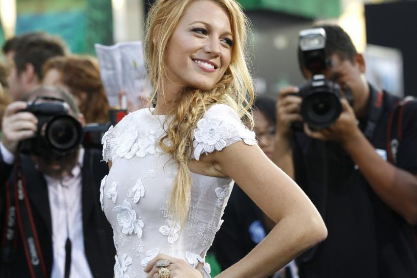 """Cast member Blake Lively poses at the premiere of """"Green Lantern"""" at the Grauman's Chinese theatre in Hollywood, California June 15, 2011. The movie opens in the U.S. on June 17."""