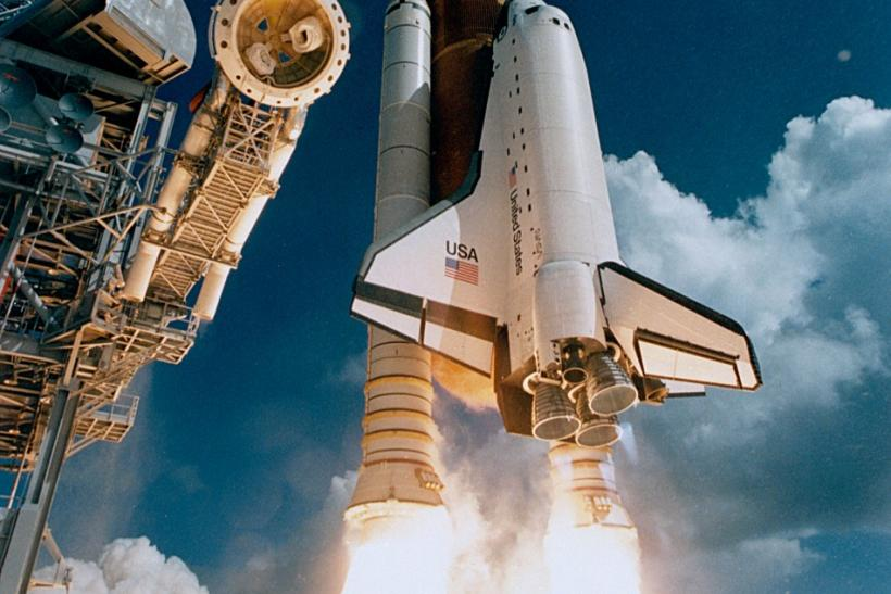 Space Shuttle Atlantis lifting off from Kennedy Space Center