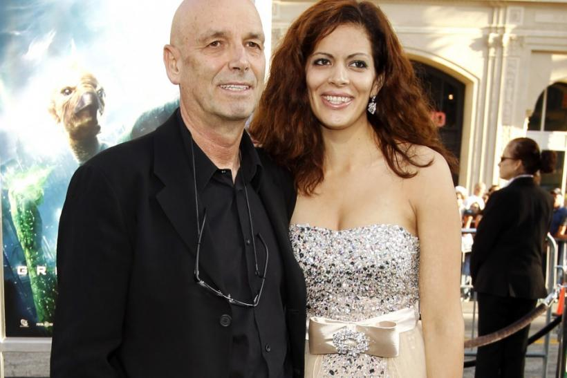 "Director Martin Campbell and his wife Sol E. Romero pose at the premiere of his movie ""Green Lantern"" at the Grauman's Chinese theatre in Hollywood, California June 15, 2011. The movie opens in the U.S. on June 17."