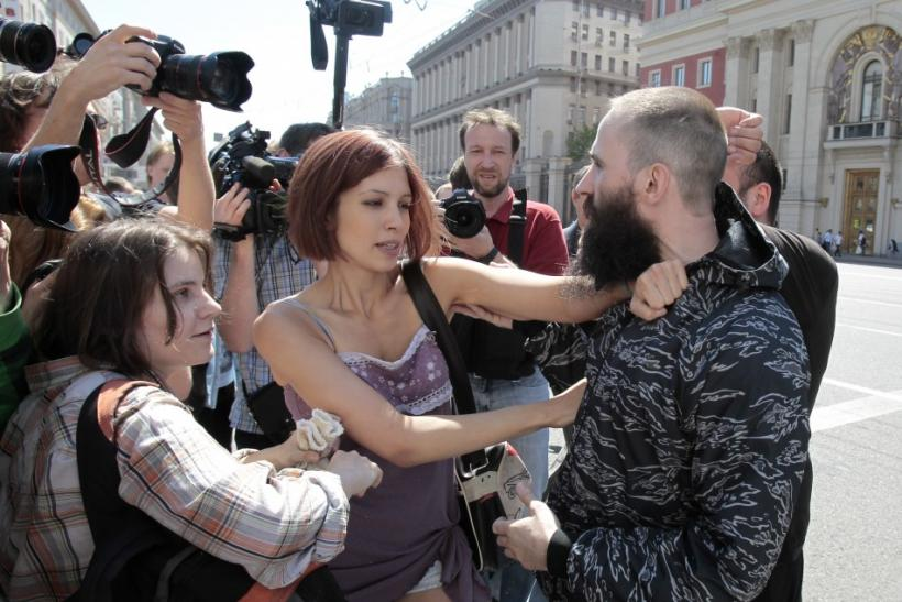 Gay rights activist (L and 2nd L front) argue with Russian nationalists