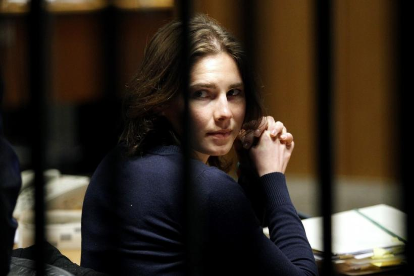 Knox, the U.S. student convicted of killing her British flatmate in Italy three years ago, sits in the courtroom after a break during a trial session in Perugia