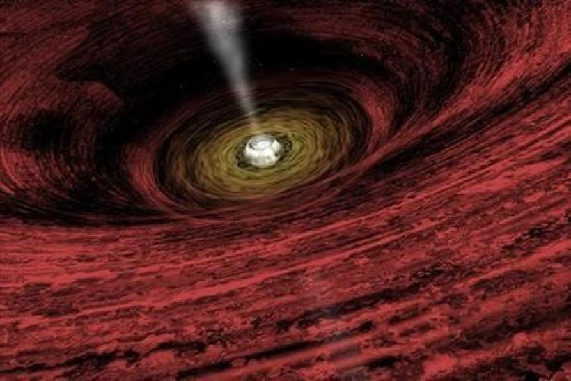 An artist's impression of a growing supermassive black hole located in the early Universe is seen in this NASA handout illustration released on June 15, 2011.