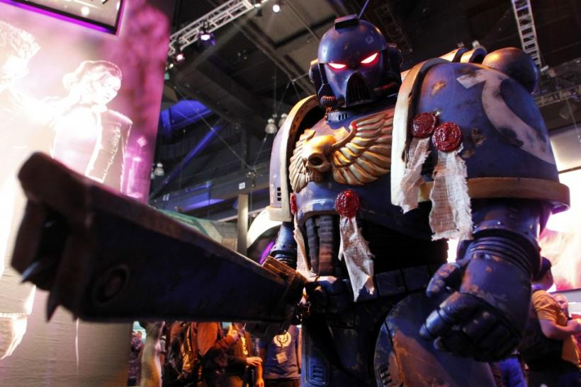 "A character from the video game ""Warhammer 40,000: Space Marine"" developed by Relic Entertainment and published by THQ poses during the Electronic Entertainment Expo or E3 in Los Angeles"