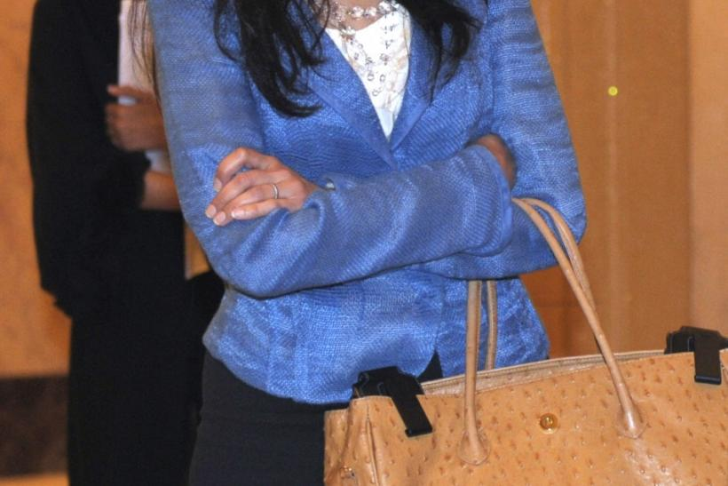 Huma Abedin, aide to U.S. Secretary of State Clinton, heads to a meeting at the Emirates Palace Hotel in Abu Dhabi