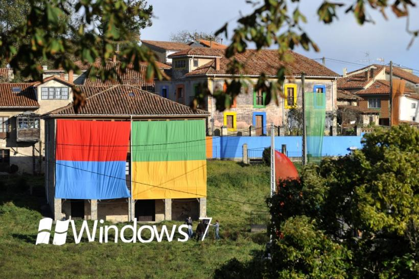 Men set up a 'Windows 7' logo during the presentation of Windows 7 in the village of Sietes