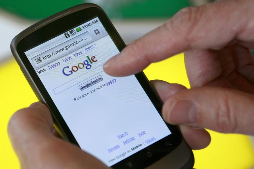 A man searches on Google from his smartphone
