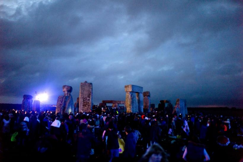 Revellers surround the ancient Stonehenge