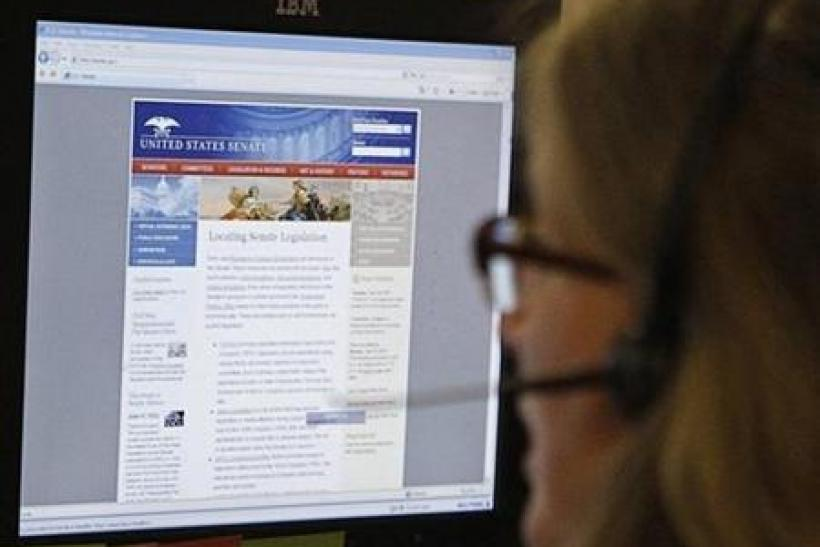 A journalist checks the Senate's website after it was attacked by internet hackers in Washington June 13, 2011.