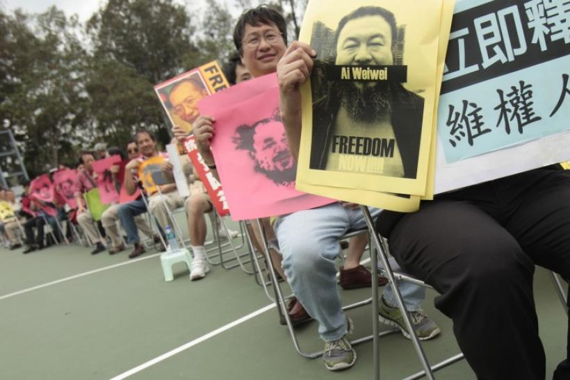 Activists hold Weiwei posters at protest