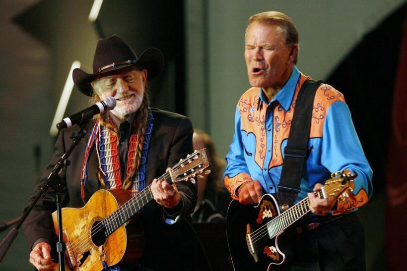 Willie Nelson and Glen Campbell perform on stage at the 20th Autry National Center gala at the Gene Autry Western Heritage museum in Los Angeles