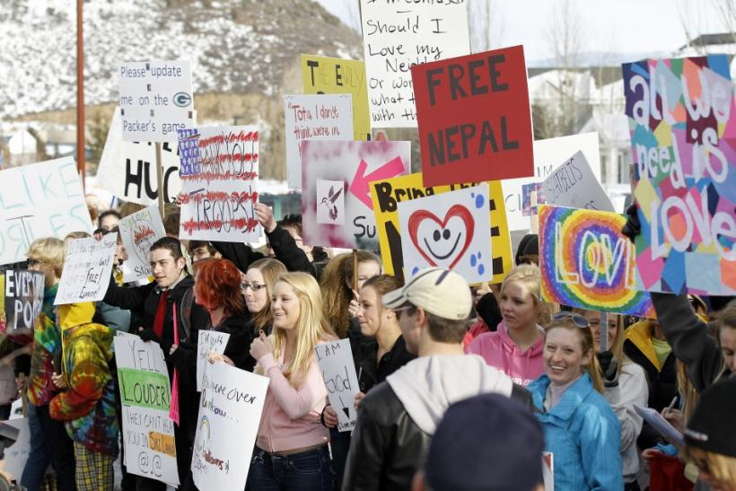 "Students hold signs across from members of the Westboro Baptist Church protesting the upcoming premiere of ""Red State"" during the Sundance Film Festival in Park City"
