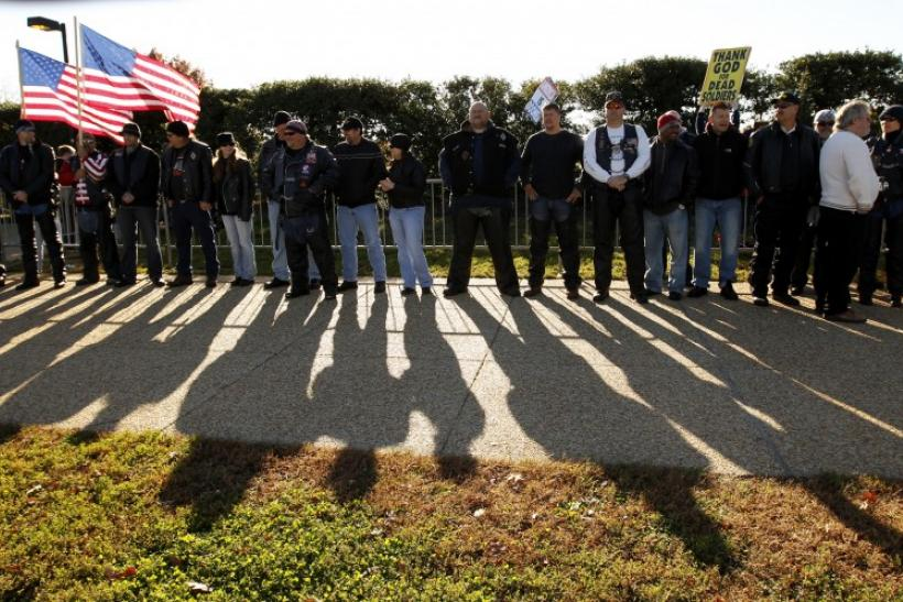 Vietnam War veterans form part of a line to block an anti-gay protest held by members of the Westboro Baptist Church at Arlington National Cemetery