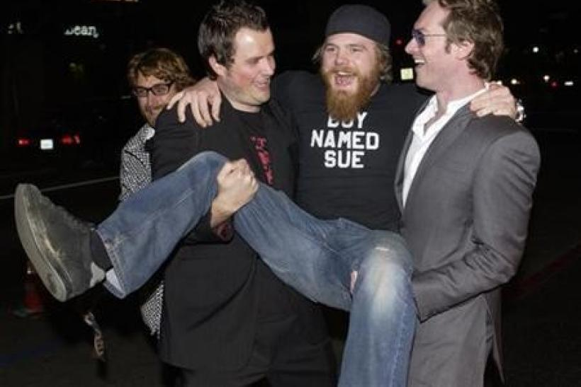 Steven Green (L), the director of ''Gumball 3000 - The Movie,'' cast member Ryan Dunn (C) and Maximillion Cooper, who launched ''Gumball 3000'' in 1999, ham it up for photographers during the premiere of the film at