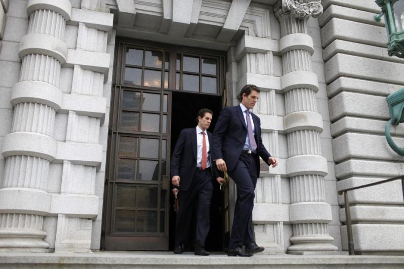 Cameron and Tyler Winklevoss leave the 9th Circuit Court of Appeals after a hearing on a settlement dispute with Facebook in San Francisco