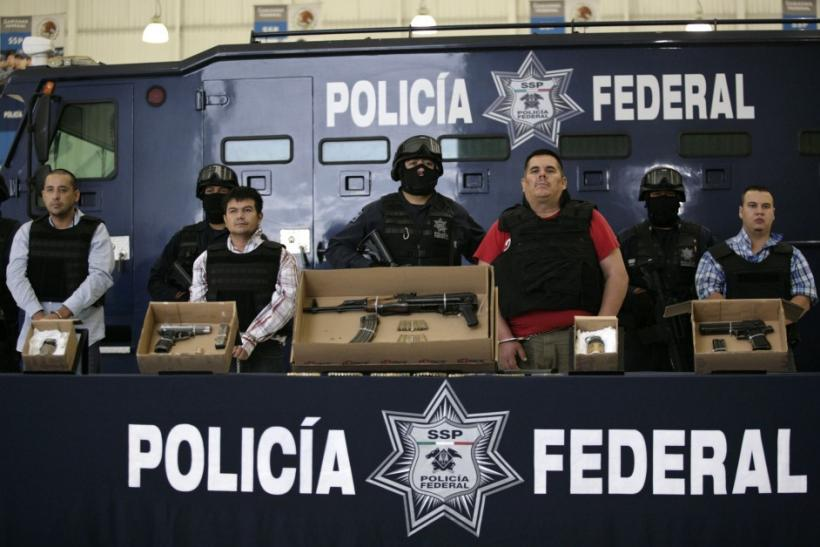 """Suspect Jose de Jesus Mendez (2nd R), known by his nickname """"El Chango,"""" or """"The Monkey"""", is being presented to the media by the police along with other suspects in Mexico City June 22, 2011."""