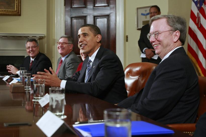 US President Obama speaks to the media alongside Google CEO Schmidt in Washington.