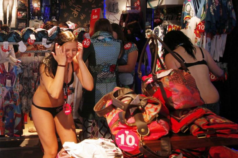 A shopper in her underwear reacts while searching for items at a Desigual store in central Prague