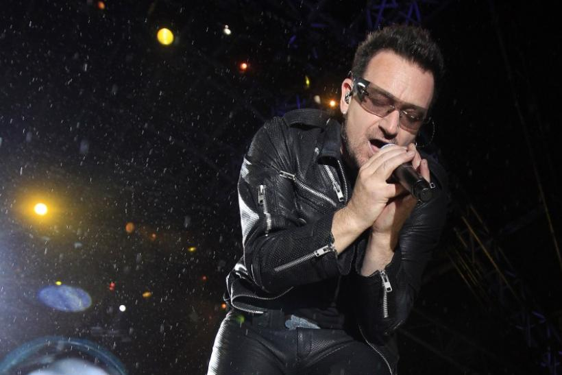 Bono, lead singer of Irish band U2, performs on the third day of the Glastonbury Festival in Worthy Farm, Somerset June 24, 2011.