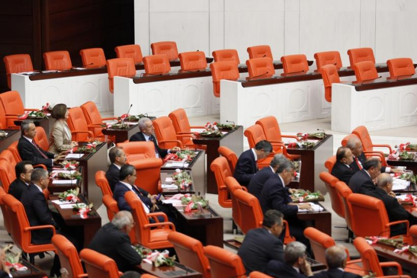 Members of far-right MHP sit next to the empty seats of the independent lawmakers supported by pro-Kurdish BDP during swearing-in ceremony in Ankara