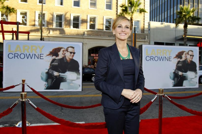 "Roberts poses at the world premiere of ""Larry Crowne"" at the Chinese theatre in Hollywood"