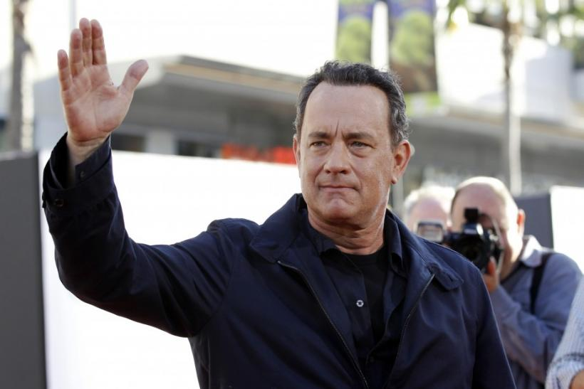 "Hanks waves at the world premiere of ""Larry Crowne"" at the Chinese theatre in Hollywood"