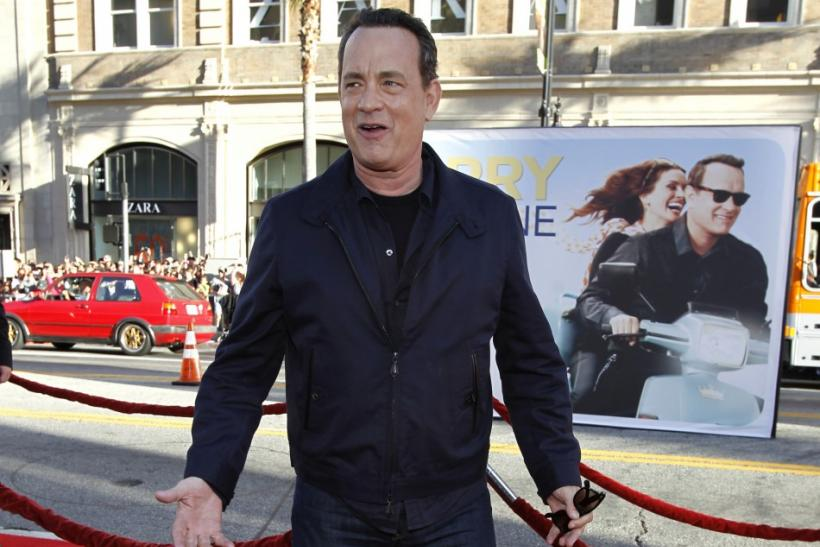 "Hanks poses at the world premiere of ""Larry Crowne"" at the Chinese theatre in Hollywood"