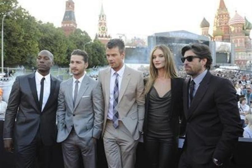 Cast members Tyrese Gibson, Shia LaBeouf, Josh Duhamel, Rosie Huntington-Whiteley, and Patrick Dempsey pose during a concert on Red Square after the premiere of Transformers: Dark of the Moon in Moscow June 23, 2011.