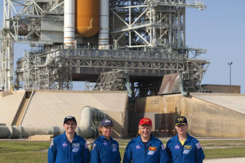 Space shuttle Atlantis STS-135 (L to R) mission specialist Rex Walheim, mission specialist Sandra Magnus, pilot Douglas Hurley and commander Christopher Ferguson pose for a photo in the flame trench of launch pad 39A at the Kennedy Space Center in Cape Ca