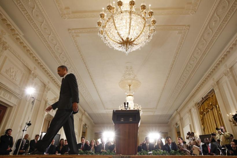 U.S. President Obama walks off stage following a news conference in Washington